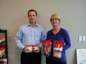 Convex Account Manager Jeremy Dimes and Sun Valley Foods General Manager Nicki Keen with four of the `new look' packs.